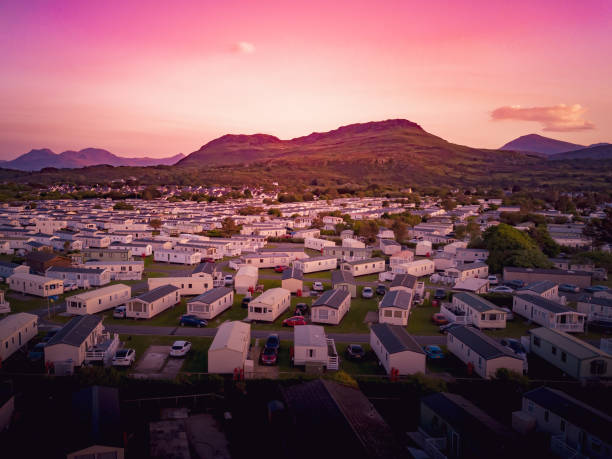 Sun set at a Caravan and camping park, static home aerial view. Porthmadog holiday park taken from the air by a drone trailer park stock pictures, royalty-free photos & images