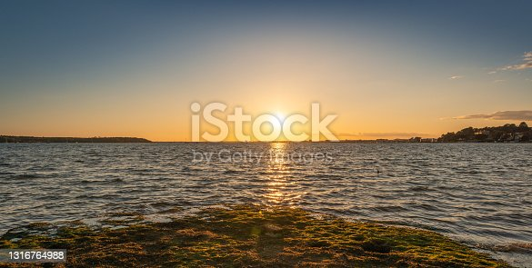 istock Sun sets on the horizon over Poole Harbour in Dorset 1316764988