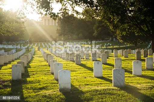Rays of light bathe the resting place of American heroes at Arlington National Cemetery