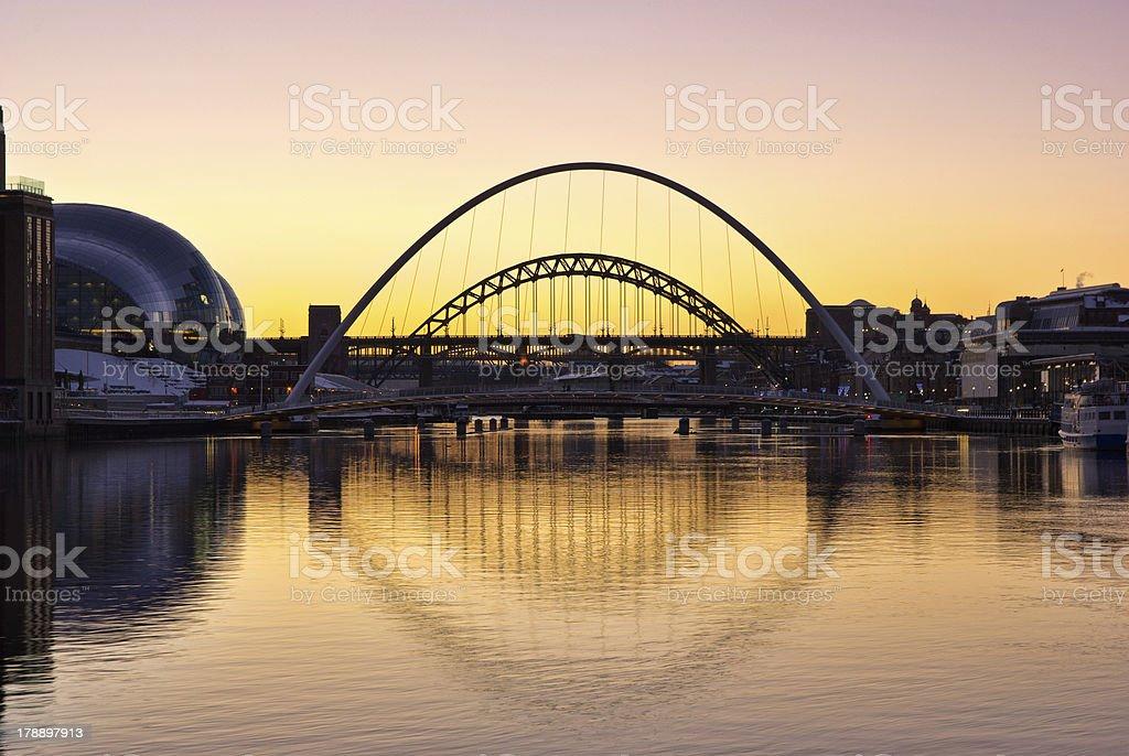 Sun setting against Tyne bridges in a romantic setting stock photo