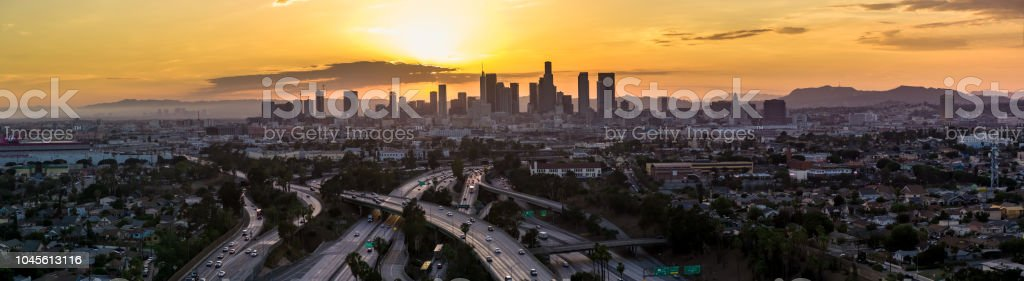 Sun Setting Behind the Downtown Los Angeles Skyline - Aerial Panorama stock photo