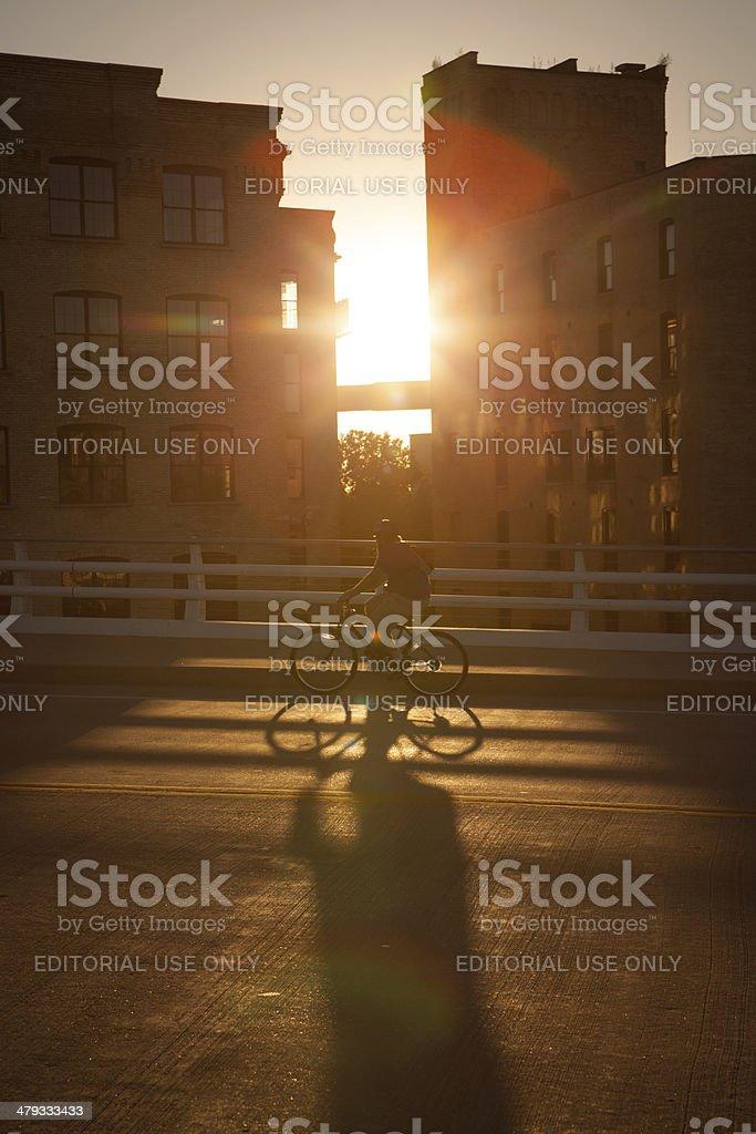 Sun setting between two buildings in Milwaukee Wisconsin stock photo