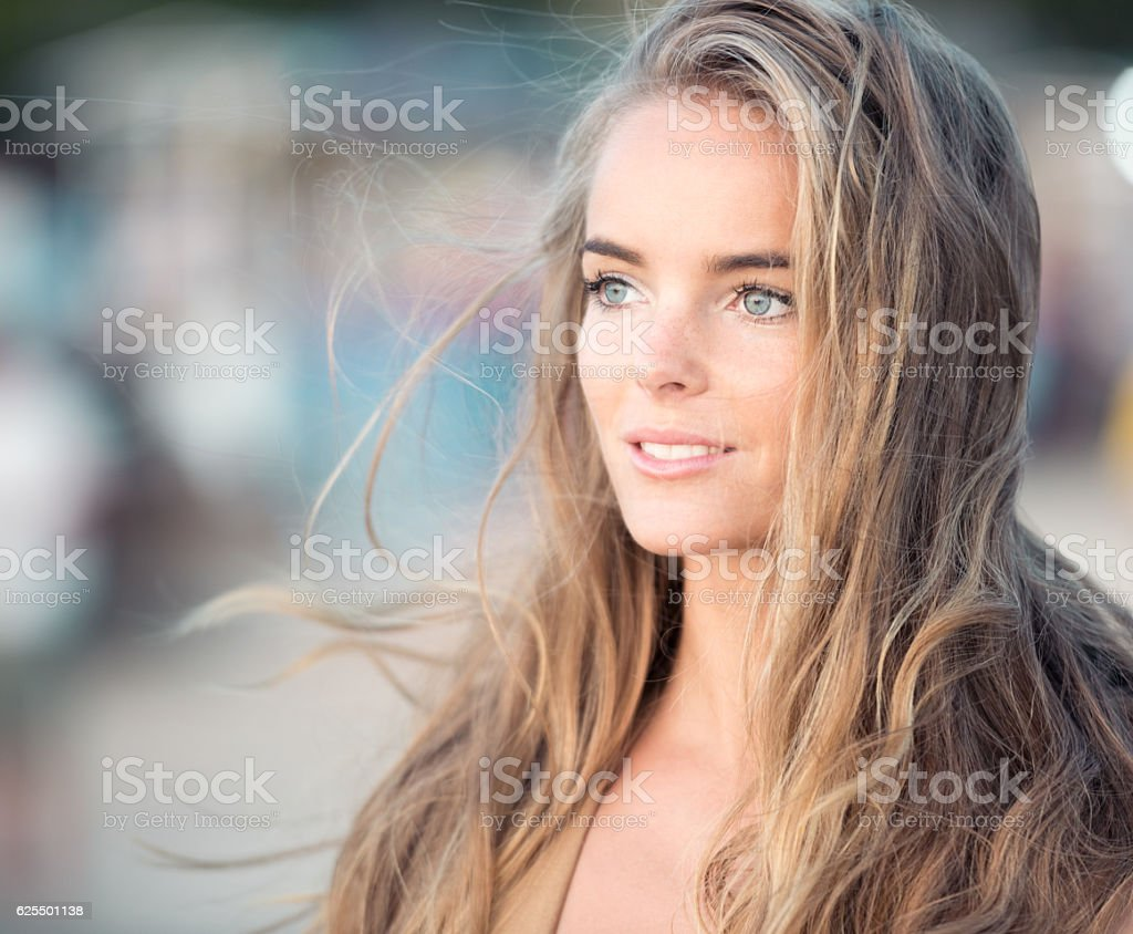 Sun setting in her eyes, Candid Beauty Portrait stock photo