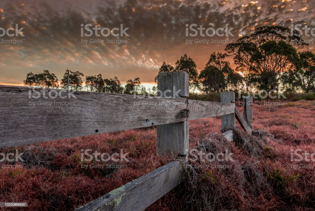 Sun setting on a rural country side setting stock photo