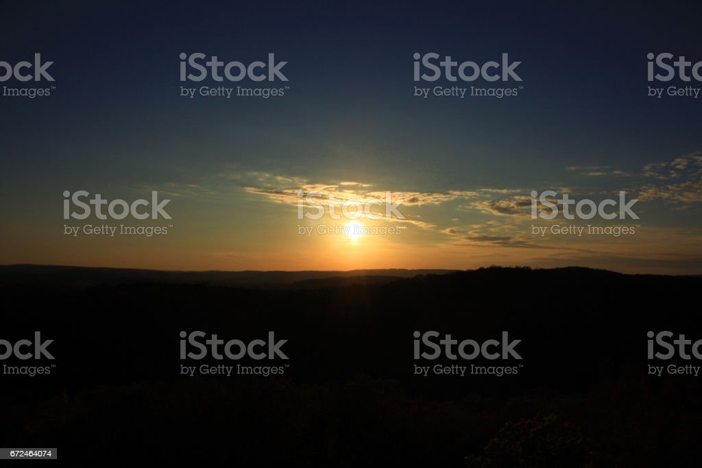 Sun Setting Over a National Forest stock photo