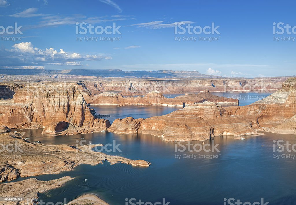 Sun setting over Lake Powell with Houseboats stock photo