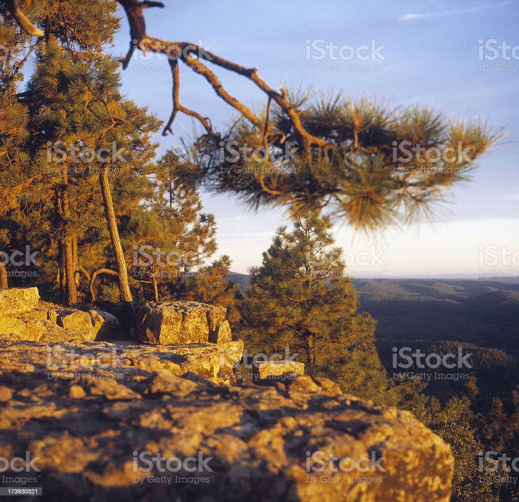 Sun setting over mountains from viewing point royalty-free stock photo