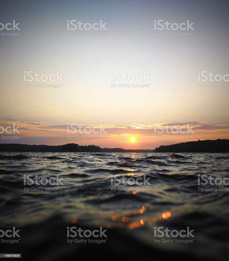 Sun setting over skyline stock photo