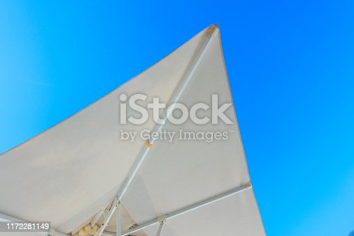 Sun shade sails with sky background.