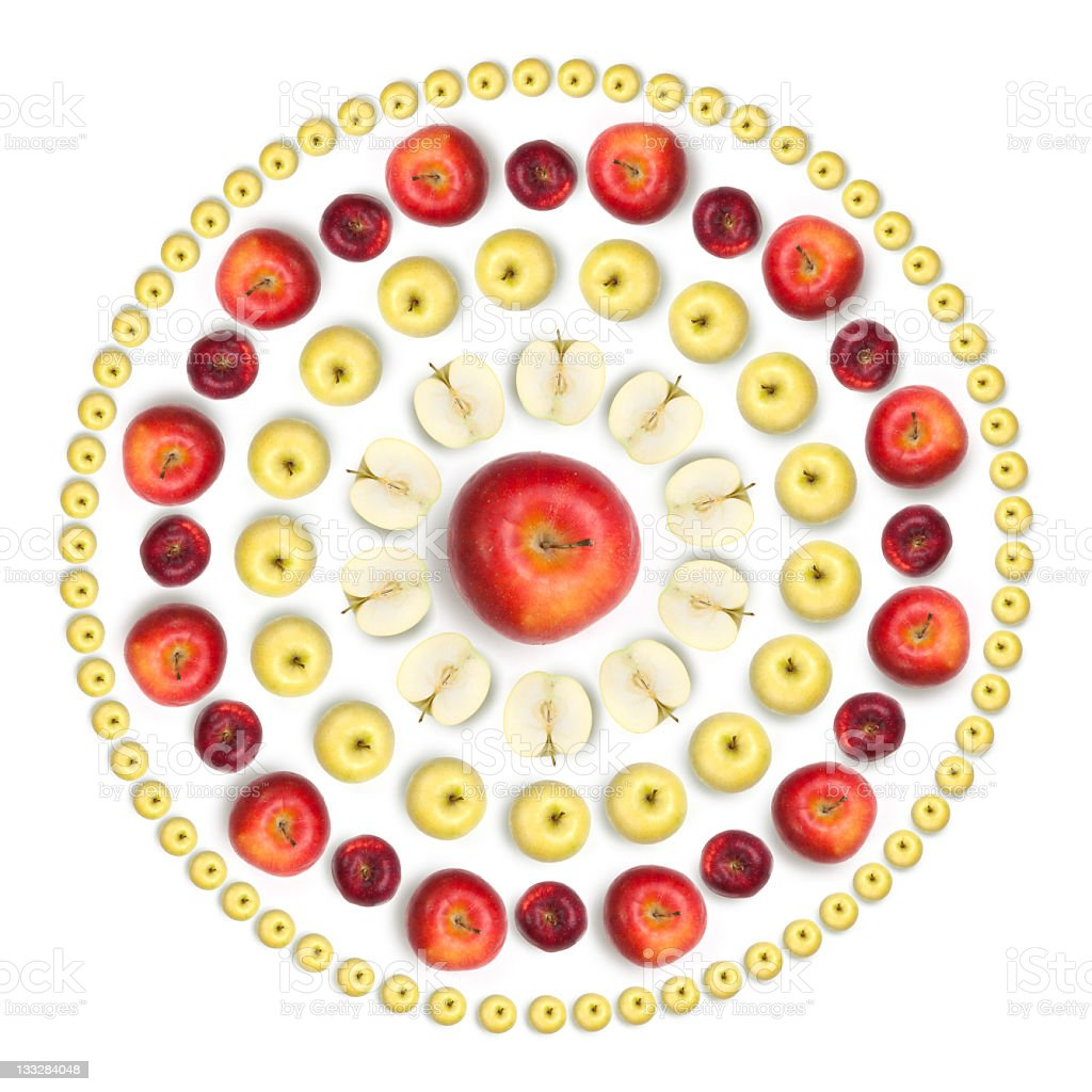 Sun shaped arrangement of healthy fruits on white background stock photo