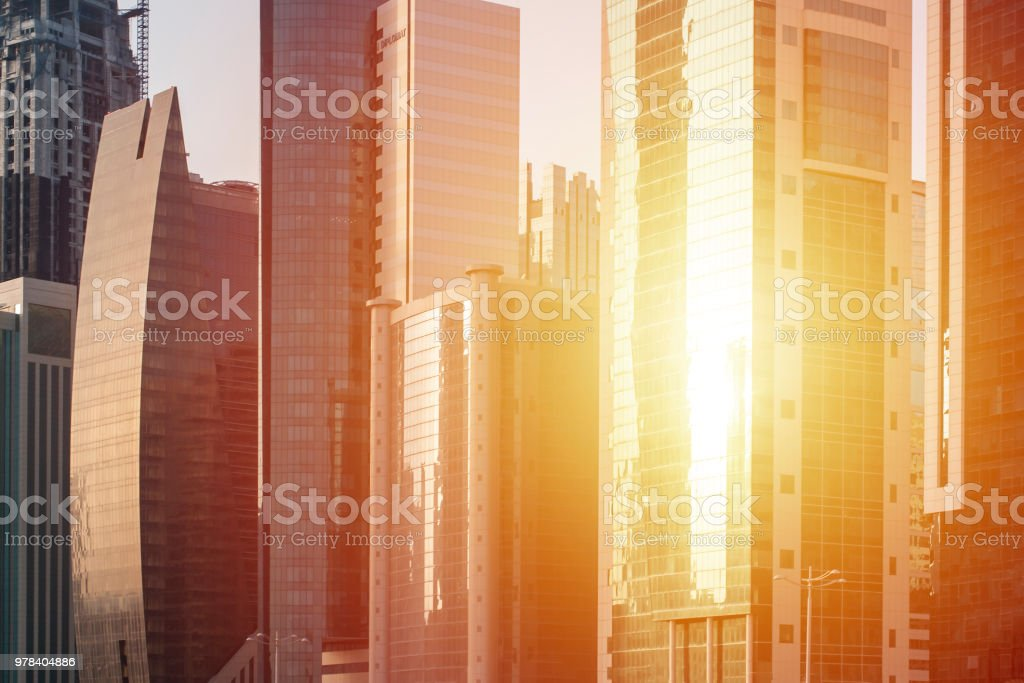 Sun shine in glass of skyscrapers windows. stock photo