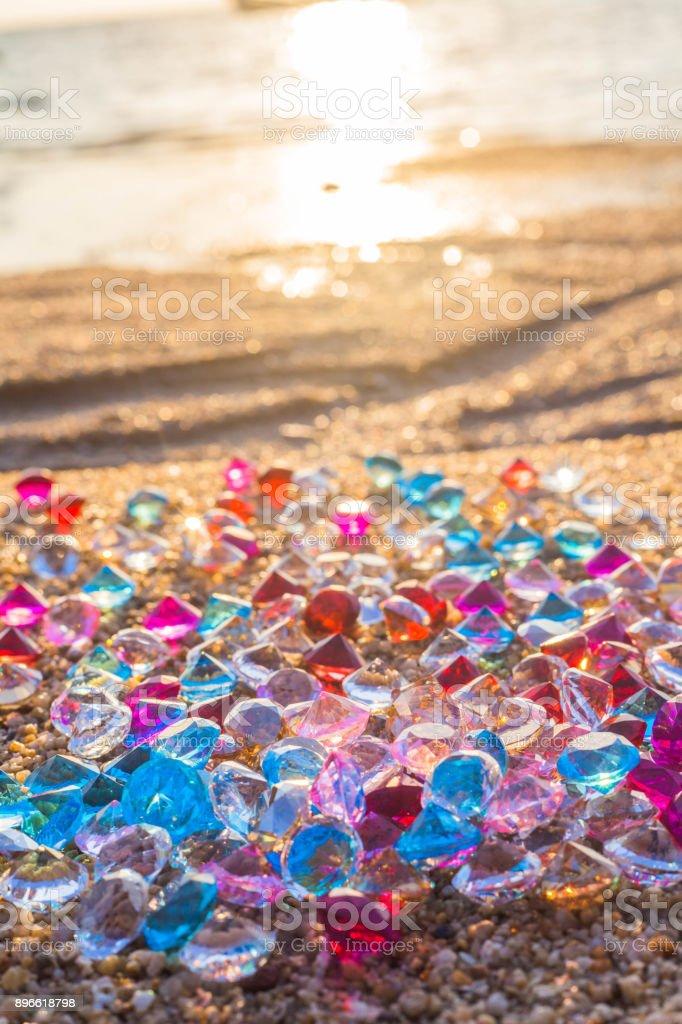 sun shine on diamonds on the beach stock photo