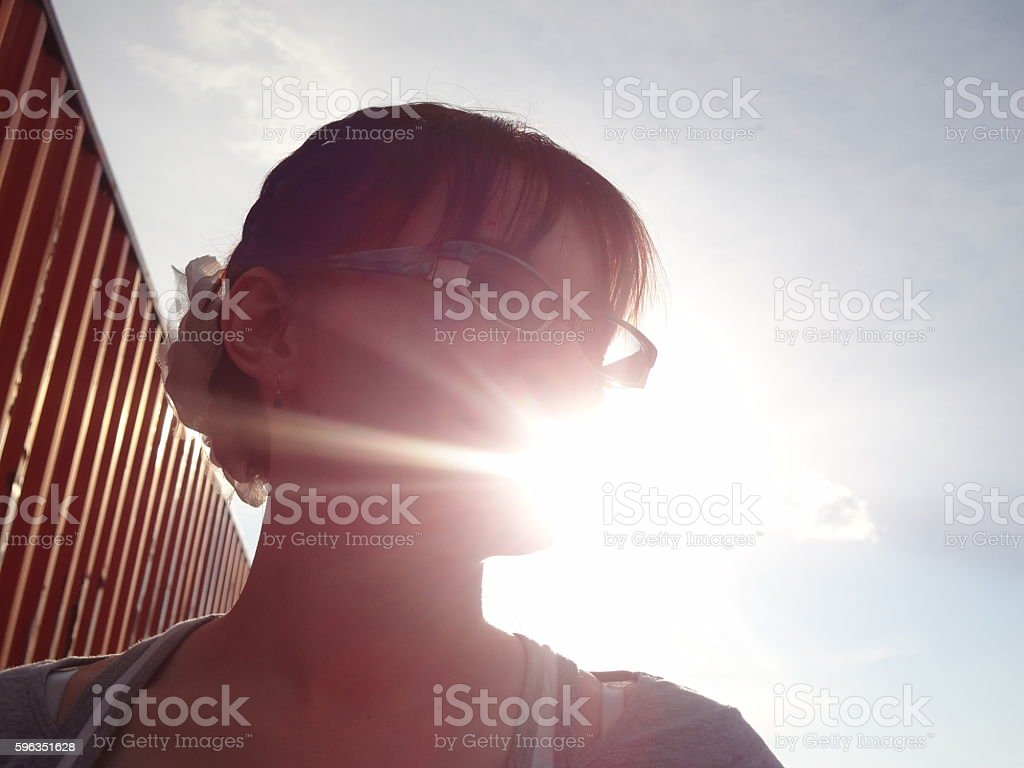 Sun shine through body and face of woman royalty-free stock photo
