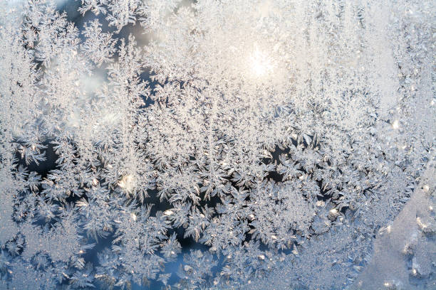 sun shine through frosted glass on window. stock photo
