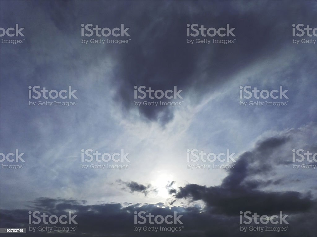 Sun shine with  dark blue clouds royalty-free stock photo