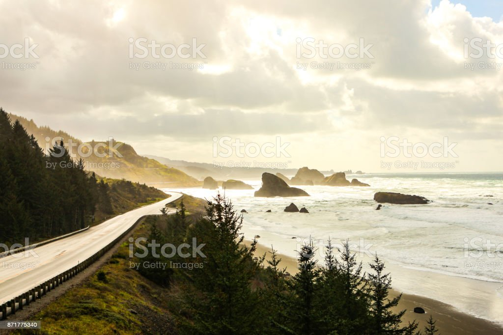 Sun shines on a coastal road stock photo