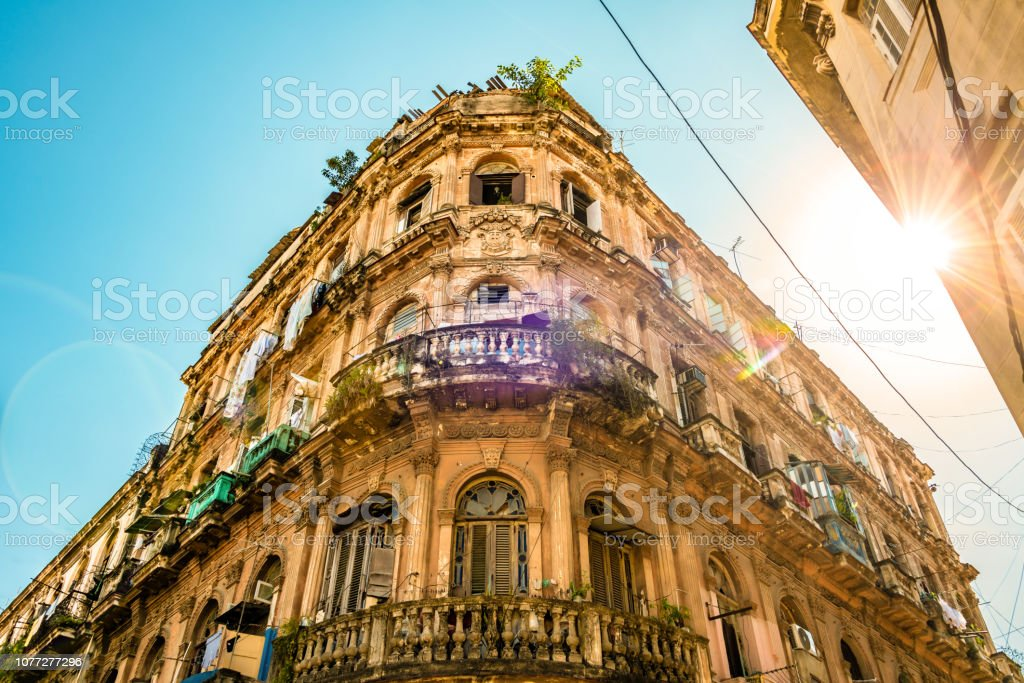 Sun shines over old apartment building in Havana stock photo