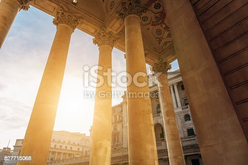 Sun shines through the colonnade of the Royal Exchange Building in the City of London