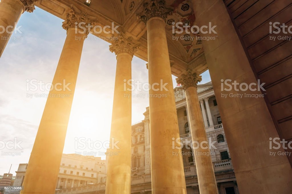 Sun shines through the colonnade of the Royal Exchange Building in the City of London stock photo