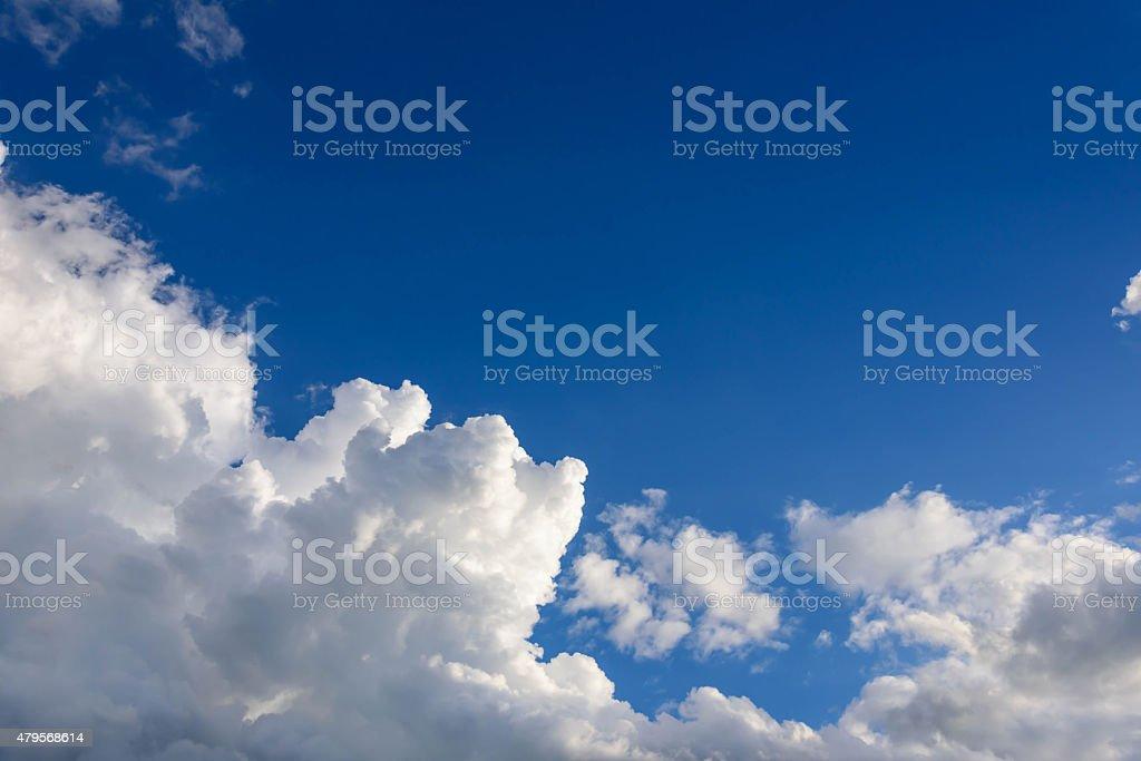 Sun shines through the rain clouds stock photo