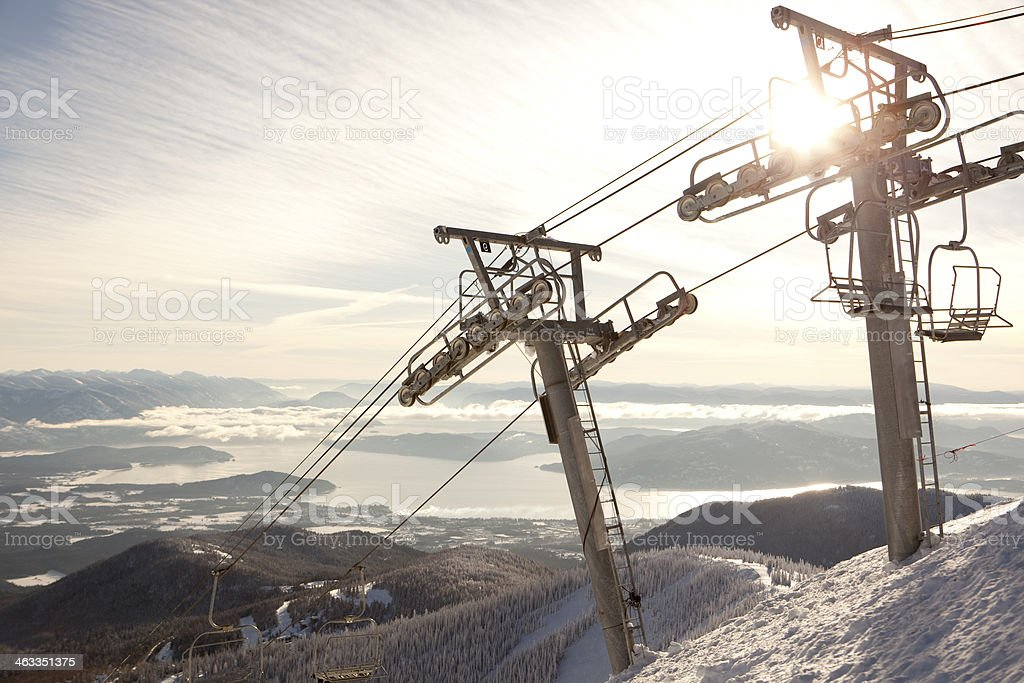 Sun shining brightly at the top of a chairlift stock photo
