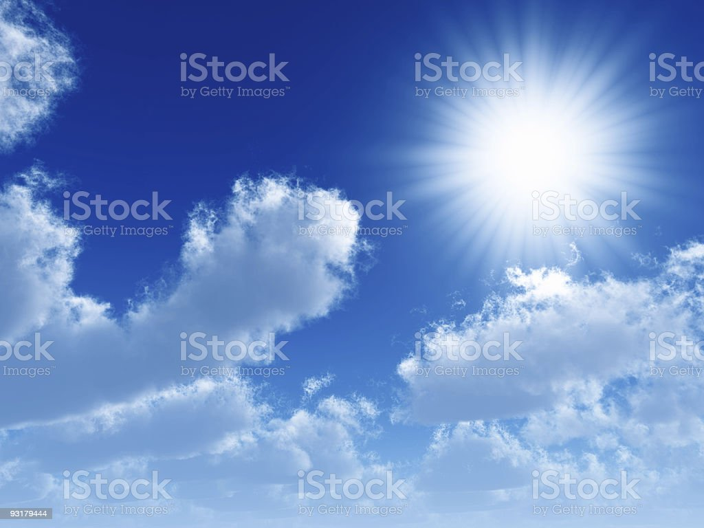 Sun shining in beams against blue sky with airy clouds stock photo