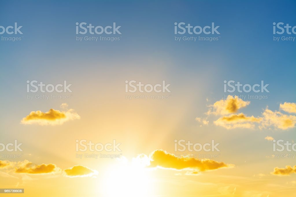 Sun shining in the blue sky at sunset - Royalty-free Atmosphere Stock Photo