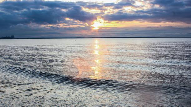 Sun shining on calm waters stock photo