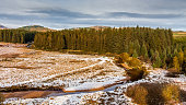 istock Sun shining over a snow covered Big Water of Fleet at the Cairnsmore of Fleet National Nature Reserve, Dumfries and Galloway, Scotland 1339809631