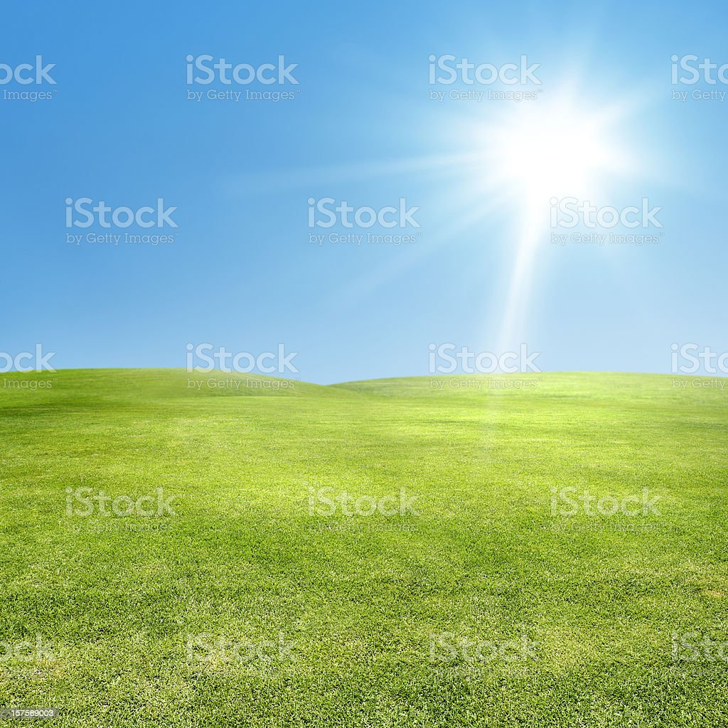 sun shining over green landscape royalty-free stock photo