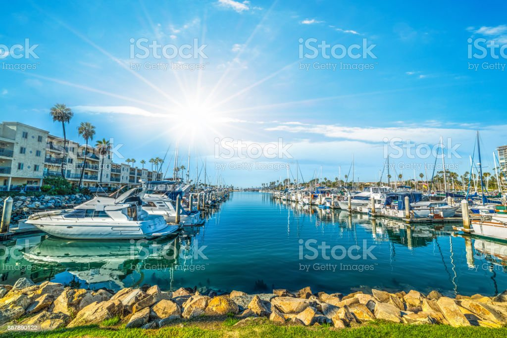 Sun shining over Oceanside harbor stock photo