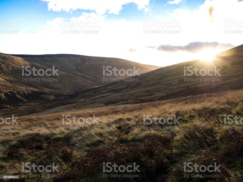 Sun Shining over the Hills and Mountains stock photo