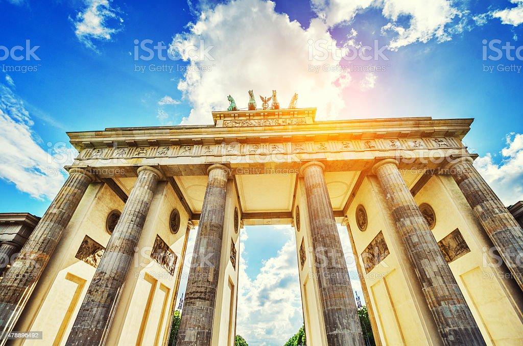 Sun Shining Through Brandenburg Gate in Berlin, Germany stock photo