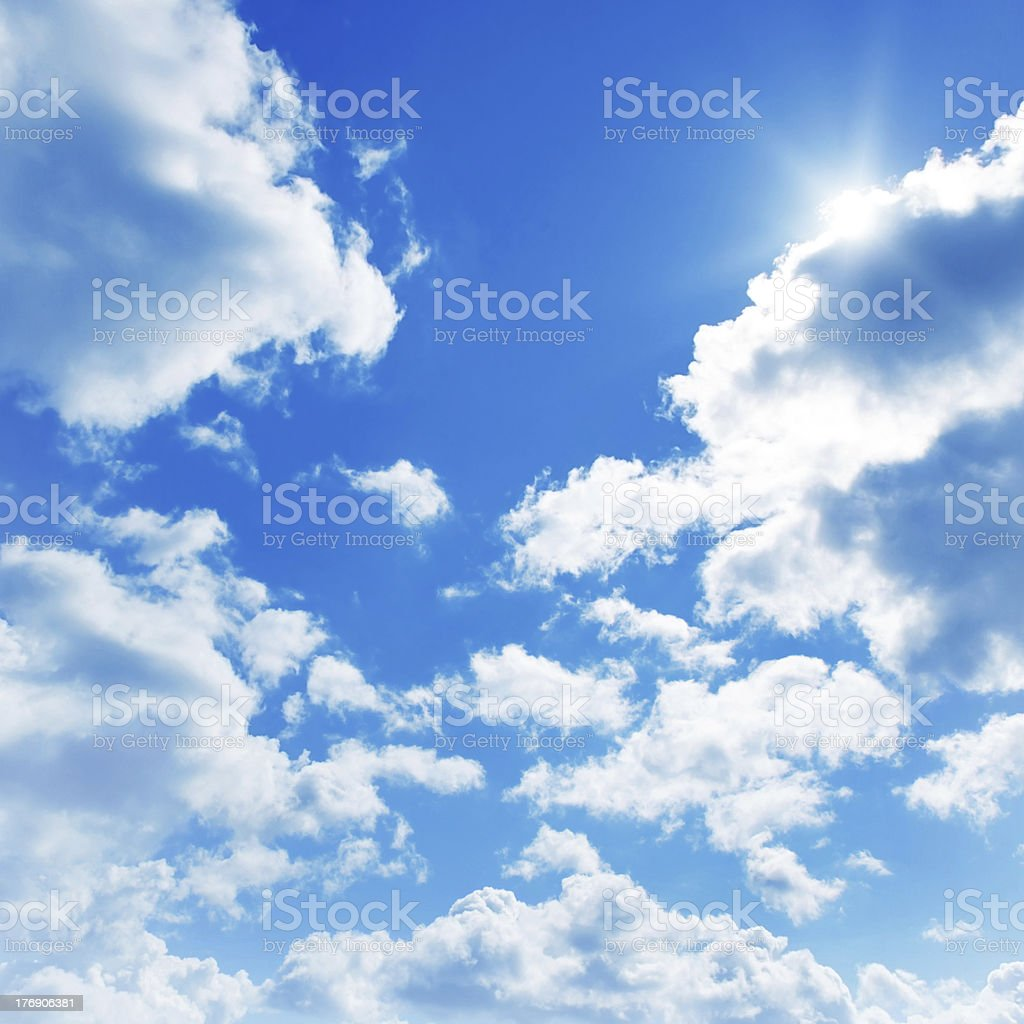 Sun shining through clouds. stock photo