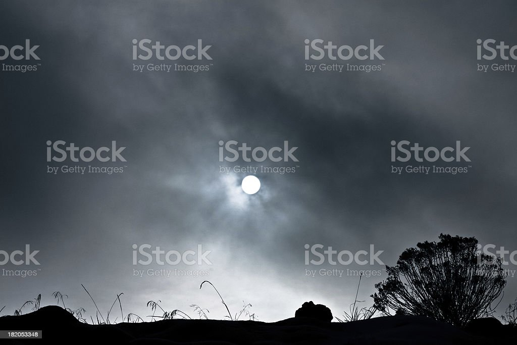 Sun Shining Through Heavy Clouds And Fog stock photo