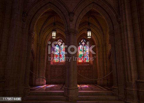 691464522 istock photo sun shining through stained glass church windows 1179574496