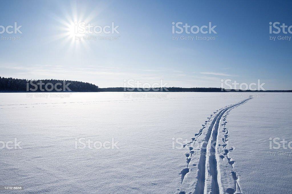 Sun, snow and Ski track stock photo