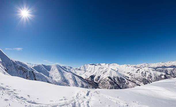 Sun star glowing over snowcapped mountain range italian alps picture id516362434?b=1&k=6&m=516362434&s=612x612&w=0&h=ztsn1bqrhsrcrscfp8evuwpu8alfdkdu8agr4w6psuw=