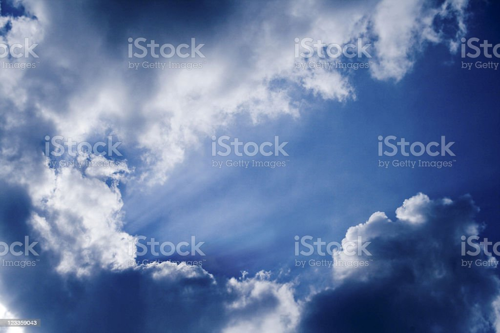 Sun streams and clouds royalty-free stock photo