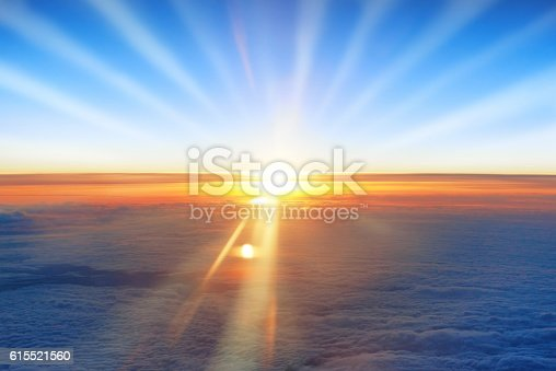 istock Sun, sunset, blue sky, and ocean of clouds 615521560