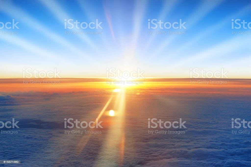 Sun, sunset, blue sky, and ocean of clouds stock photo