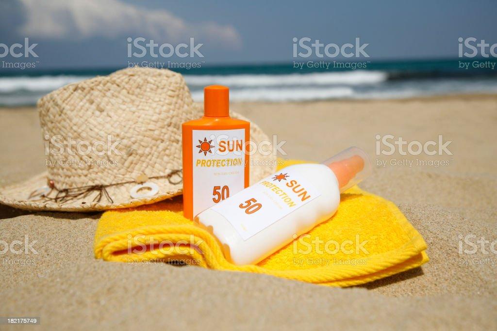 Sun Tan Lotion on a Beach stock photo
