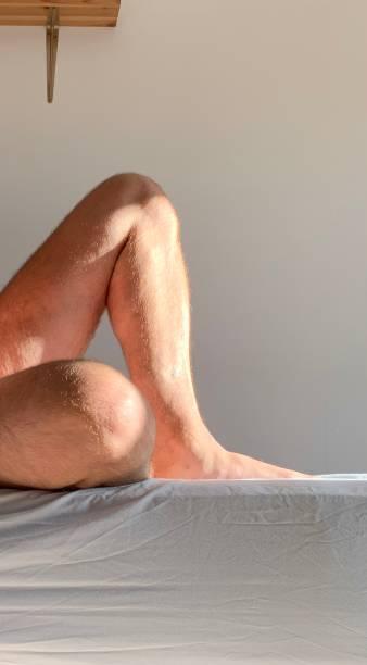 Sun tanned legs. stock photo