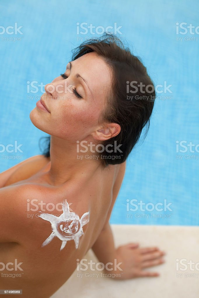 sun tanning woman sitting on pool royalty-free stock photo