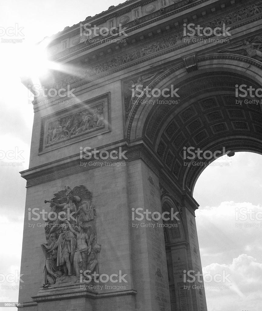 sun through an arch de triomphe in Paris royalty-free stock photo