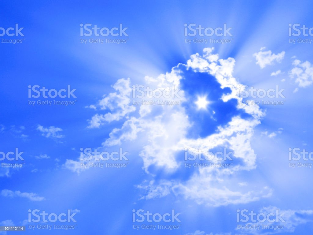 Sun through clouds, sunbeams, sky only, six-pointed star stock photo