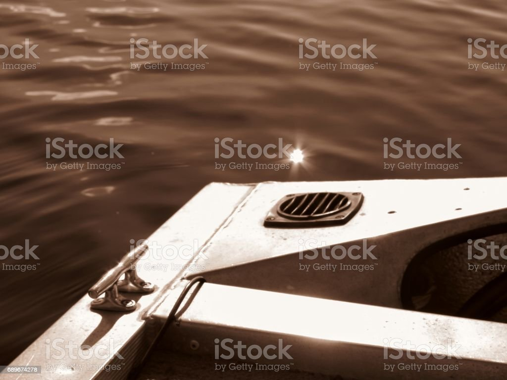 Sun Twinkle on Water, Bassboat, Rippled Water, Copy Space stock photo