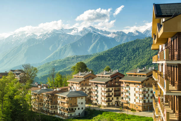 Sun view of the plateau, hotel complexes and mountains. Rosa Khutor, Sochi - May 29, 2017: Mountain Village in the summer. sochi stock pictures, royalty-free photos & images