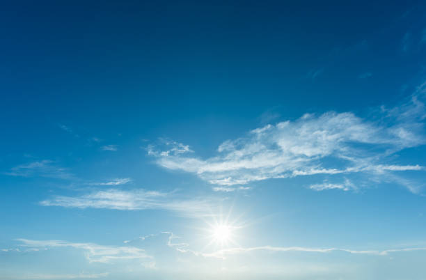 Sun with sunlight in cloud on blue sky stock photo