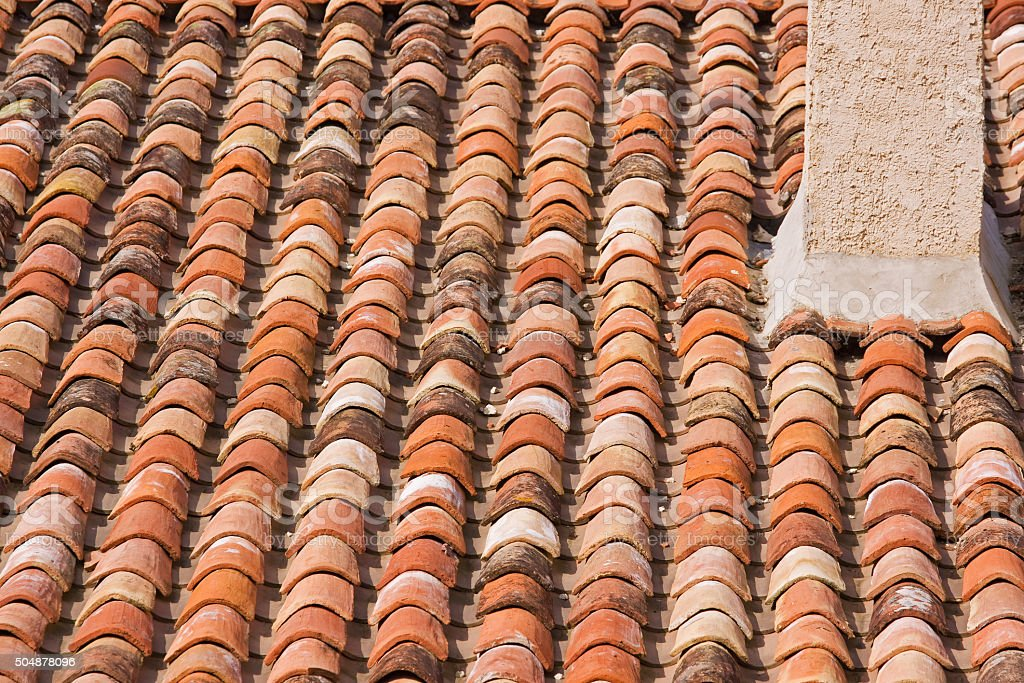 Sunbaked clay roof tiles in southern France stock photo